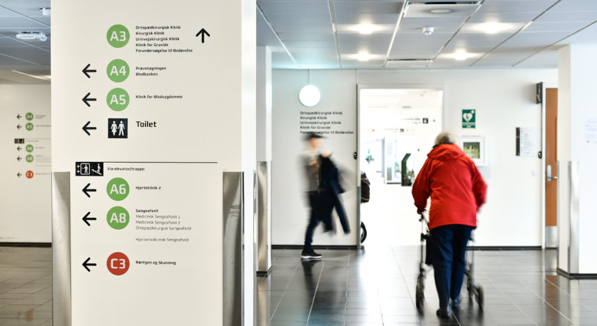 Wayfinding signage pointing towards different hospital departments