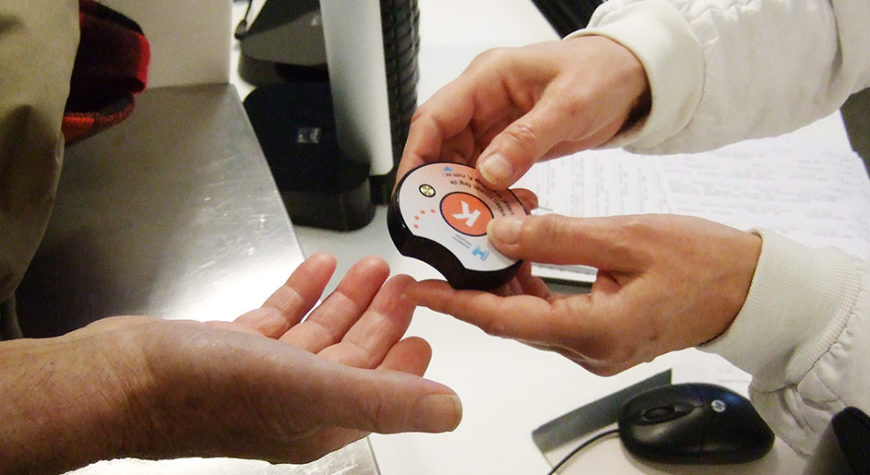 The SafeBuzz being handed to a patient at Hvidovre Hospital