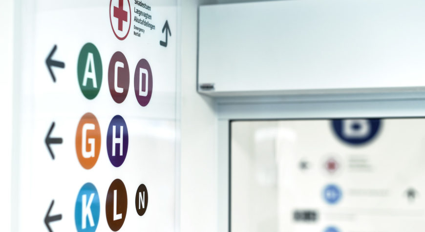Signage using a combination of colours, letters and symbols to ensure that as many as possible can read and understand the patient wayfinding.